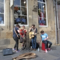 Buskers (with an impromptu guest) on the Royal Mile